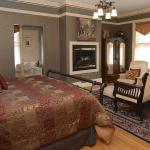 This spacious room has a see through fireplace and king bed