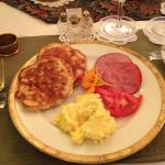 Breakfast main course--eggs, nutty pancakes and ham.
