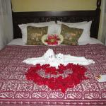 Bed with welcome towel animal and rose petals