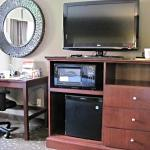 Microwave, Fridge, Flat Screen TV, desk and comfy chair.
