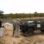 A pit stop during an afternoon game drive. Drinks and snacks next to a dam just before sunset.
