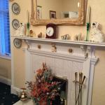 Dining with decorative fireplace