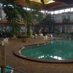 The indoor pool and in the back you can see room rooms.