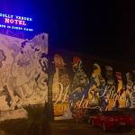 Exterior murals on the hotel (this is their parking lot also) and the original neon sign