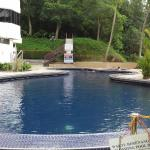 View of pool in front of building