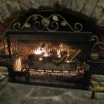 charming decor throughout including artistic fireplace screens