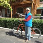 My husband with free bike in front of rooms