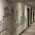 Hallway with custom-designed Chicago skyline wallpaper
