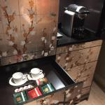 Nespresso machine and display of coffee options in drawer