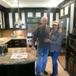Hubby and me in fully appointed kitchen featuring Viking appliances
