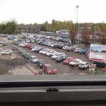 car parking and train station seen from room window