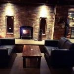 The main Bar area with a cosy wood stove.... Relaxed and inviting