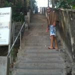 Me on the stairs leading to beach and fruit stand