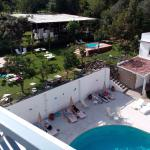 View from roof of main building onto pool and garden area