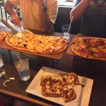 the founder's pie and a create your own large pizza on top, big kahuna on gluten free crust belo