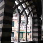 View from front portico through windows out onto the Piazza del Duomo