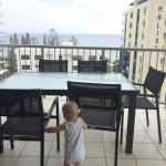 Our little guy checking out the view from the balcony.