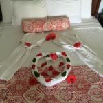 Bathr robes folded and sprinkled with Flowers