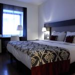 Bed and bedroom at Hotel Palazzo Zichy in Budapest