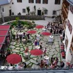 a wedding with oompa band in Schloss Mittersill courtyerd