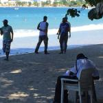 """Drug """"thugs"""" just past security guard on the beach."""