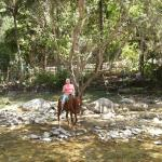 Riding through the Cuale River