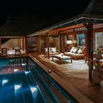 The deck at Villa two provides a relaxing ambiance for unwinding under the stars.