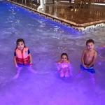 Three of our 6 grandchildren enjoying the pool area