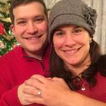 Engagement pic in front of one of the trees inside the Gingerbread House