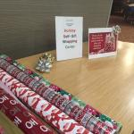 Great idea! A wrapping station in the lobby around the holidays.