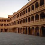 Hotel exterior and huge paved courtyard