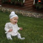 our baby playing in the grass in the outdoor sitting area