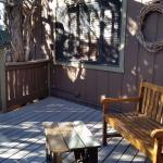 Patio with sliding door entrance into suite. Window is the neighboring room.