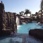 Cascade feature to pool with poolside restaurant background