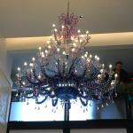 Beautiful chandelier above check in desk