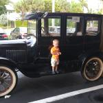 My boy with the old Ford outside