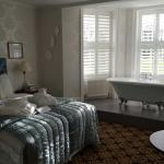Love the bath in the window bay over looking the front lawn.