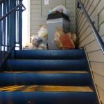 Garbage at the top of the stairs.