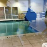Pool (fitness center reflected in glass)