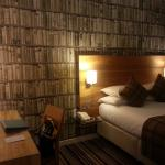 Nice,warm,cosy room with lovely wallpaper.