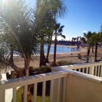 Our Balcony view of the cove, sandy beach and swaying Palm Trees