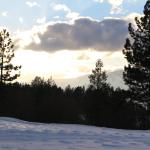 view of snowcapped golf course on west side of property