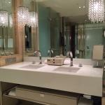 Beautifully decorated bathroom complete with a variety of toiletries.
