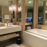 Bathtub complete with flat screen TV.