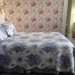Tiny double bed with no space for night stand on one side
