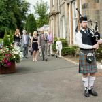 Piper walking guests to ceremony