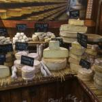 Some of the local cheeses for sale at the Sunday farmers market set up right in front of the hot