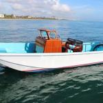 Small fishing charter boat available for hire near the motel