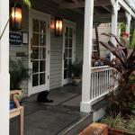 Front porch of the office complete with one of the two resident cats.