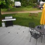 Great patio with gas grill and table.